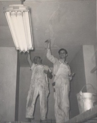 Painters painting light fitting